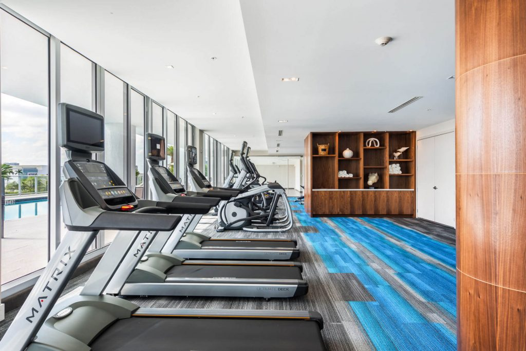 Fitness Room treadmills and bookshelves
