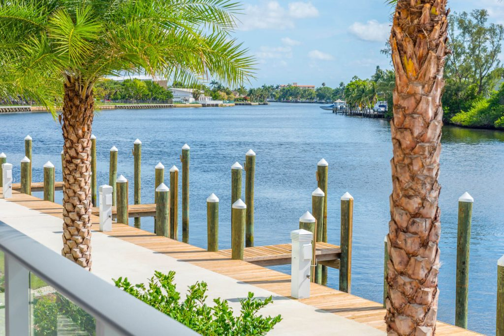 Balcony View of private docks with palm trees