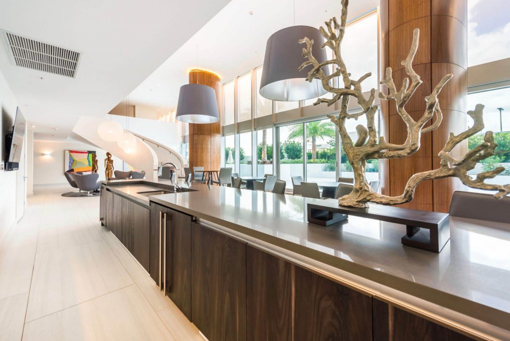 Residents Lounge with modern art tree fixture and modern seating areas