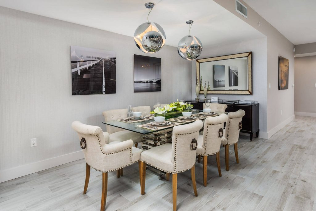 Residence modern dining room table with modern decorative artwork